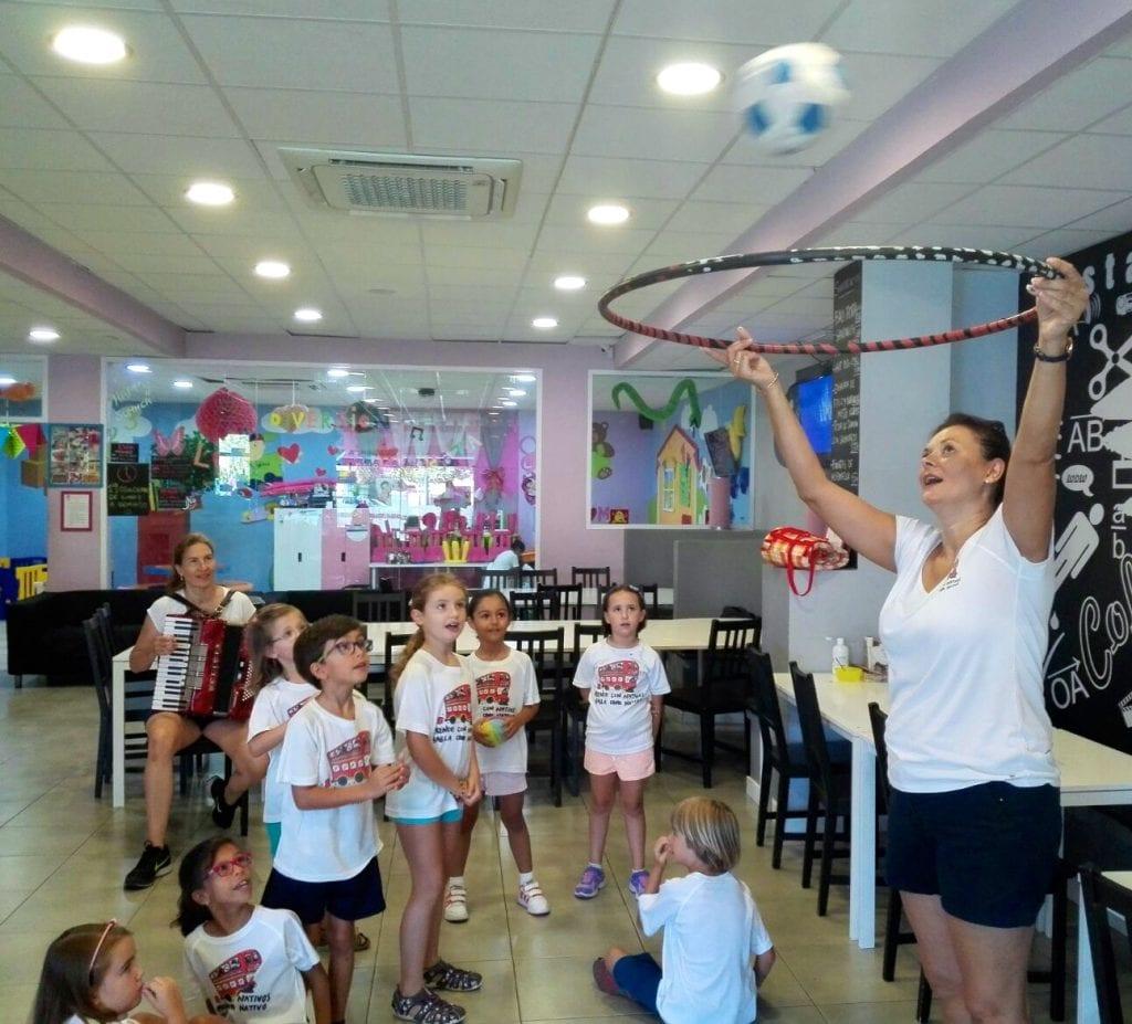 Miss Aloma playing basket and singing